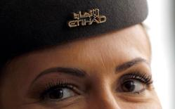 An Etihad flight attendant is seen during a news conference at Malpensa Airport near Milan, October 20, 2014. REUTERS/Alessandro Garofalo