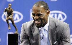 LeBron James laughs as he waits to address the media in Miami, Florida May 12, 2012.  REUTERS/Rhona Wise