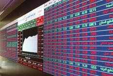 Share prices are seen on an electronic display at the Doha Stock Exchange in Doha, Qatar June 3, 2015. REUTERS/Naseem Zeitoon