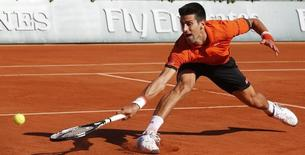 Novak Djokovic of Serbia returns the ball to Rafael Nadal of Spain during their men's quarter-final match during the French Open tennis tournament at the Roland Garros stadium in Paris, France, June 3, 2015.        REUTERS/Jean-Paul Pelissier