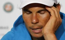 Rafael Nadal of Spain attends a news conference after being defeated by Novak Djokovic of Serbia during their men's quarter-final match at the French Open tennis tournament at the Roland Garros stadium in Paris, France, June 3, 2015.             REUTERS/Vincent Kessler