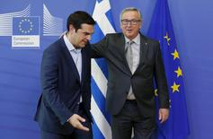 Greek Prime Minister Alexis Tsipras (L) poses with European Commission President Jean-Claude Juncker ahead of a meeting at the EU Commission headquarters in Brussels, Belgium, June 3, 2015. REUTERS/Francois Lenoir