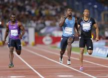 Justin Gatlin from the U.S. crosses the finish line first to win the men's 100 meters event during the Golden Gala IAAF Diamond League at the Olympic stadium in Rome, Italy June 4, 2015. REUTERS/Giampiero Sposito
