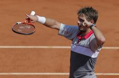 Stan Wawrinka of Switzerland celebrates after defeating Jo-Wilfried Tsonga of France during their men's semi-final match at the French Open tennis tournament at the Roland Garros stadium in Paris, France, June 5, 2015. REUTERS/Vincent Kessler