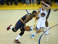Cleveland Cavaliers guard Kyrie Irving (2) moves the ball against the defense of Golden State Warriors guard Klay Thompson (11) during the second half in game one of the NBA Finals. at Oracle Arena.Kelley L Cox-USA TODAY Sports