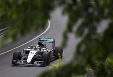 Mercedes Formula One driver Lewis Hamilton of Britain drives his car during the second practice session of the Canadian F1 Grand Prix at the Circuit Gilles Villeneuve in Montreal June 5, 2015. REUTERS/Christinne Muschi