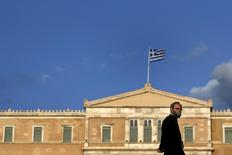 An Orthodox priest walks in front of the parliament building in Athens June 6, 2015. REUTERS/Alkis Konstantinidis