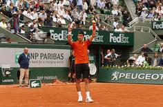 Tennis - French Open - Roland Garros, Paris, France - 26/5/15. Men's Singles - Serbia's Novak Djokovic joins in with the crowd during a Mexican Wave during the first round. Action Images via Reuters / Jason Cairnduff Livepic