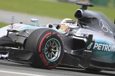 Mercedes driver Lewis Hamilton takes a curve during the Canadian F1 Grand Prix at the Circuit Gilles Villeneuve in Montreal June 7, 2015.   REUTERS/Christinne Muschi