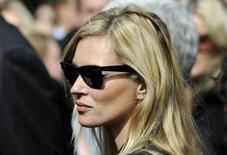British model Kate Moss leaves the memorial service for Alexander McQueen at St. Paul's Cathedral, London, September 20, 2010.    REUTERS/Paul Hackett