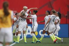 United States midfielder Megan Rapinoe (15) celebrates scoring against Australia with forward Abby Wambach (20) and Megan Klingenberg defender (22) and midfielder Carli Lloyd (10)  in a Group D soccer match in the 2015 women's World Cup at Winnipeg Stadium on Jun 8, 2015.  USA TODAY Sports Images