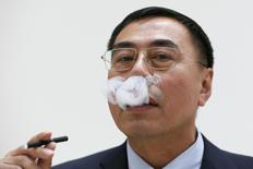 Chinese inventor of the e-cigarette Hon Lik poses for a photograph in central London, Britain June 9, 2015. REUTERS/Stefan Wermuth