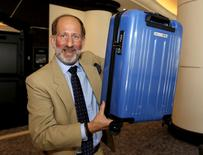 Thomas Windmuller, a vice president of the International Air Transport Association (IATA), holds a carry-on bag which conforms to a new minimum size announced by the group in an effort to get world airlines to sign on to the standard, at the group's annual meeting in Miami Beach, Florida, June 9, 2015.  REUTERS/Joe Skipper