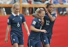 Jun 9, 2015; Moncton, New Brunswick, CAN; France forward Eugenie Le Sommer (9) celebrates with midfielder Elodie Thomis (12) after scoring a goal against England during the first half in a Group F soccer match in the 2015 FIFA women's World Cup at Moncton Stadium. Mandatory Credit: Matt Kryger-USA TODAY Sports