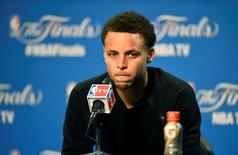 Jun 9, 2015; Cleveland, OH, USA; Golden State Warriors guard Stephen Curry addresses the media after game three of the NBA Finals at Quicken Loans Arena. Cleveland won 96-91. Mandatory Credit: David Richard-USA TODAY Sports