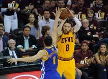 Jun 9, 2015; Cleveland, OH, USA; Cleveland Cavaliers guard Matthew Dellavedova (8) shoots against Golden State Warriors guard Klay Thompson (11) during the first quarter of game three of the NBA Finals at Quicken Loans Arena. Mandatory Credit: Ken Blaze-USA TODAY Sports
