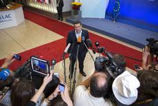 Le Premier ministre grec Alexis Tsipras à Bruxelles. Les dirigeants de l'Allemagne, de la France et de la Commission européenne ont sommé mercredi la Grèce de s'entendre avec ses créanciers internationaux plutôt que de chercher à obtenir des conditions plus avantageuses à des fins politiques.  /Photo prise le 11 juin 2015/REUTERS/Yves Herman