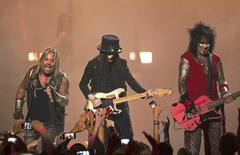 Motley Crue band members Vince Neil (L), Mick Mars (C), and Nikki Sixx perform during the 2014 iHeartRadio Music Festival in Las Vegas, Nevada September 19, 2014.  REUTERS/Steve Marcus