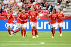 Jun 12, 2015; Vancouver, British Columbia, CAN; Switzerland celebrates after Switzerland midfielder Fabienne Humm (16) scored a goal during the second half against Ecuador in a Group C soccer match in the 2015 FIFA women's World Cup at BC Place Stadium. Mandatory Credit: Anne-Marie Sorvin-USA TODAY Sports