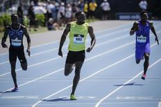 Usain Bolt (C) of Jamaica crosses the finish line to win the 200m at the IAAF Diamond League Grand Prix track and field competition in New York June 13, 2015. REUTERS/Eduardo Munoz