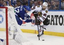 Jun 13, 2015; Tampa, FL, USA; Chicago Blackhawks center Antoine Vermette (80) battles for the puck with Tampa Bay Lightning defenseman Andrej Sustr (62) in the third period game five of the 2015 Stanley Cup Final at Amalie Arena. Mandatory Credit: Kim Klement-USA TODAY Sports