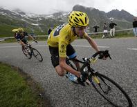 Race leader jersey holder Team Sky rider Christopher Froome of Britain cycles during the 204.5 km stage of the centenary Tour de France cycling race from Bourg d'Oisans to Le Grand Bornand, in the French Alps, July 19, 2013.  REUTERS/Jacky Naegelen