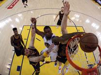 Golden State Warriors forward Harrison Barnes (40) dunks the ball over Cleveland Cavaliers guard Mike Miller (18) and center Timofey Mozgov (20) in game five of the NBA Finals at Oracle Arena on Jun 14, 2015. Ezra Shaw-Pool Photo via USA TODAY Sports