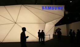 Visitors walk past the Samsung stand at the Mobile World Congress in Barcelona February 24, 2014. REUTERS/Gustau Nacarino
