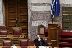 Greek Finance Minister Yanis Varoufakis listens to a question during a parliamentary session in Athens June 11, 2015. REUTERS/Alkis Konstantinidis - RTX1G21U