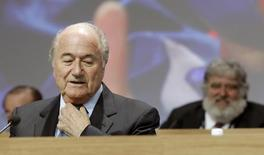 A file picture shows FIFA President Sepp Blatter (L) standing in front of executive member Chuck Blazer of the U.S. during the 61st FIFA congress at the Hallenstadion in Zurich June 1, 2011. REUTERS/Arnd Wiegmann/Files