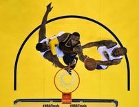 Jun 14, 2015; Oakland, CA, USA; Cleveland Cavaliers forward LeBron James (23) shoots the ball against Golden State Warriors forward Draymond Green (23) and guard Andre Iguodala (9) in game five of the NBA Finals at Oracle Arena. John G. Mabanglo-Pool Photo via USA TODAY Sports