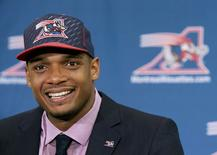 Newly signed defensive end Michael Sam smiles as he is introduced to the media by the Montreal Alouettes CFL football team in Montreal, in this file photo taken May 26, 2015. REUTERS/Christinne Muschi/Files
