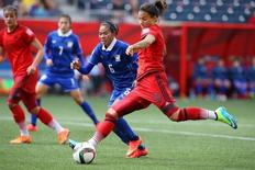 Jun 15, 2015; Winnipeg, Manitoba, CAN; Germany midfielder Dzsenifer Marozsan (10) drives the ball upfield against Thailand midfielder Pikul Khueanpet (6) in the first half of a Group B soccer match in the 2015 FIFA women's World Cup at Winnipeg Stadium. Mandatory Credit: Bruce Fedyck-USA TODAY Sports