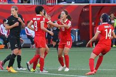 Jun 15, 2015; Winnipeg, Manitoba, CAN; China PR players react after a goal by midfielder Wang Lisi on a penalty kick against New Zealand in the first half of a Group A soccer match in the 2015 FIFA women's World Cup at Winnipeg Stadium. Mandatory Credit: Bruce Fedyck-USA TODAY Sports