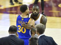 Cleveland Cavaliers forward LeBron James shakes hands with Golden State Warriors guard Stephen Curry during the fourth quarter of game six of the NBA Finals in Cleveland, June 16, 2015. David Richard-USA TODAY Sports