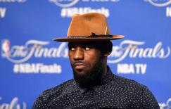 Jun 16, 2015; Cleveland, OH, USA; Cleveland Cavaliers forward LeBron James (23) talks to the media after game six of the NBA Finals against the Golden State Warriors at Quicken Loans Arena. Ken Blaze-USA TODAY Sports