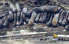 A firefighter stands close to the remains of a train wreckage in Lac Megantic July 8, 2013. REUTERS/Mathieu Belanger