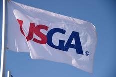 Jun 17, 2015; University Place, WA, USA; USGA flags on top of the first hole grandstand during practice rounds on Wednesday at Chambers Bay. Michael Madrid-USA TODAY Sports