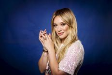 "Actress and singer Hilary Duff poses for a portrait while promoting her new album ""Breathe In. Breathe Out."" in New York June 17, 2015. REUTERS/Lucas Jackson"