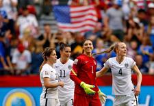 Jun 16, 2015; Vancouver, British Columbia, CAN; United States goalkeeper Hope Solo (1) and defender Becky Sauerbrunn (4) and defender Meghan Klingenberg (22) and defender Ali Krieger (11) celebrate their win over Nigeria in a Group D soccer match in the 2015 FIFA women's World Cup at BC Place Stadium. Mandatory Credit: Michael Chow-USA TODAY Sports