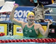 Kylie Palmer of Australia reacts after winning the women's 200m freestyle swimming heats during the Commonwealth Games in New Delhi October 4, 2010.   REUTERS/Tim Wimborne