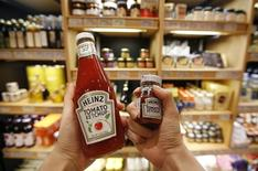 A woman holds different sizes of tomato ketchups at a store selling small-sized products for single-person households at a department store in this photo illustration taken in Seoul October 28, 2014. REUTERS/Kim Hong-Ji