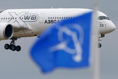 An Airbus A350 flies over a Boeing flag while landing after a flying display during the 51st Paris Air Show at Le Bourget airport near Paris, June 18, 2015. REUTERS/Pascal Rossignol