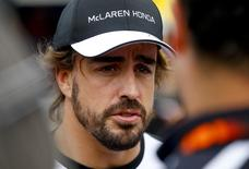 McLaren Honda Formula One driver Fernando Alonso of Spain talks to journalists in the paddock ahead of the Austrian F1 Grand Prix at the Red Bull Ring circuit in Spielberg, Austria, June 18, 2015.   REUTERS/Leonhard Foeger