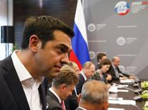 Greek Prime Minister Alexis Tsipras (L) arrives for a meeting with Russian President Vladimir Putin (C) at the St. Petersburg International Economic Forum 2015 (SPIEF 2015) in St. Petersburg, Russia, June 19, 2015. REUTERS/Grigory Dukor