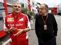Ferrari Formula One team leader Maurizio Arrivabene (L) and Sergio Marchionne, CEO of Fiat Chrysler automobil arrive in the paddock before the start of the Austrian F1 Grand Prix at the Red Bull Ring circuit in Spielberg, Austria, June 21, 2015.  REUTERS/Leonhard Foeger