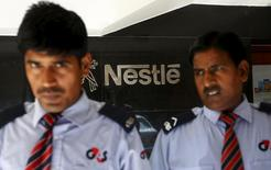 Security guards stand guard outside a corporate office of Nestle India Ltd. in New Delhi, India, June 8, 2015. REUTERS/Adnan Abidi