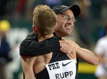 May 30, 2014; Eugene, OR, USA; Galen Rupp (USA) embraces coach Alberto Salazar   in the 40th Prefontaine Classic at Hayward Field.  Kirby Lee-USA TODAY Sports