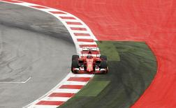 Ferrari Formula One driver Kimi Raikkonen of Finland steers his car during the qualifying session for the Austrian F1 Grand Prix at the Red Bull Ring circuit in Spielberg, Austria, June 20, 2015.  REUTERS/Leonhard Foeger