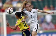 Jun 22, 2015; Edmonton, Alberta, CAN; United States defender Becky Sauerbrunn (4) and Colombia forward Lady Andrade (16) go for a head ball during the second half in the round of sixteen in the FIFA 2015 women's World Cup soccer tournament at Commonwealth Stadium. Mandatory Credit: Michael Chow-USA TODAY Sports